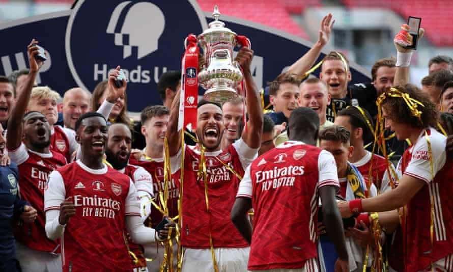 Arsenal's players celebrate winning the FA Cup earlier this month. There will be no replays, and reduced prize money, in next season's competition