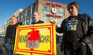 Gwen Sinclair, Sean Clerkin and James Scott of the Scottish Resistance protesting outside Tunnock's, whom they call 'a bunch of traitors and collaborators'.