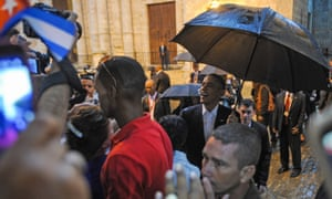 Barack Obama talks to tourists and Cubans at Havana cathedral