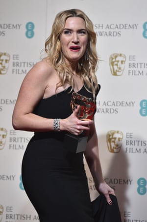 Kate Winslet poses with the award for a supporting actress for her work on the film 'Steve Jobs'