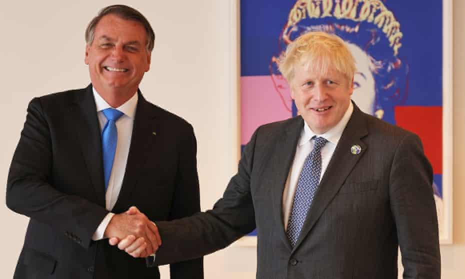 Jair Bolsonaro and Boris Johnson shake hands