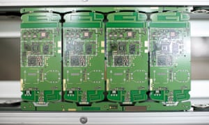 ZTE smartphone circuit boards on the assembly line in Shenzhen, China.