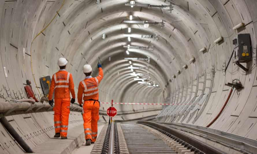 Crossrail engineers inspecting completed tracks
