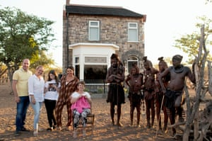Channel 4 undated handout photo of Scarlett Moffatt and members of her family with the Himba tribe in front of a replica of the Moffatt's house in County Durham