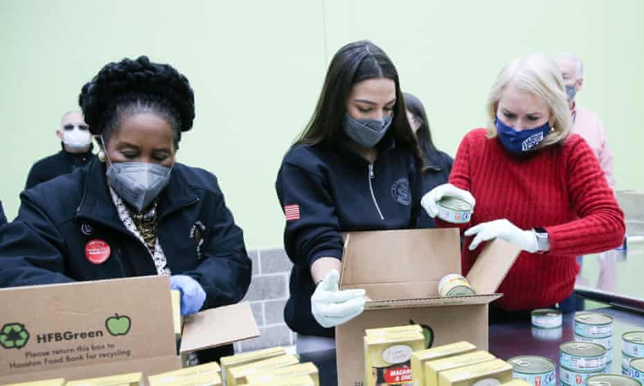 Alexandria Ocasio-Cortez with Sheila Jackson Lee and Sylvia Garcia at a food bank in Houston last week.
