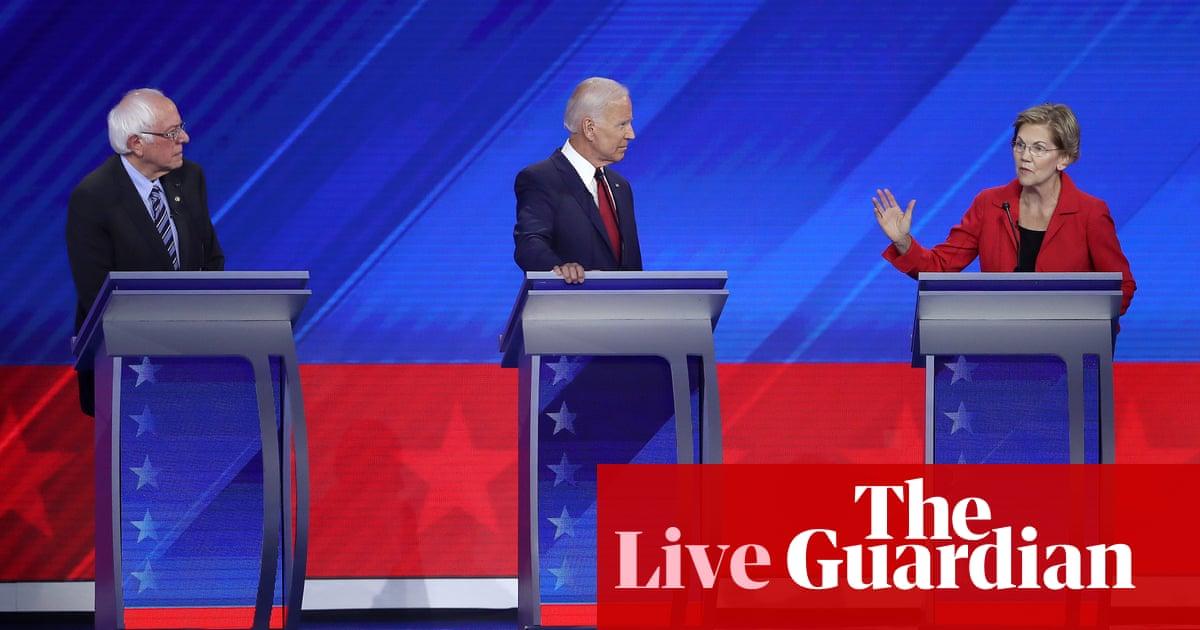 Democratic debate: Warren and Sanders clash with Biden over healthcare – live
