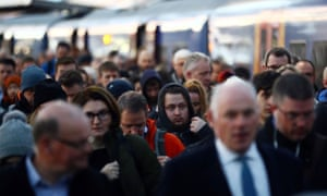 Commuters disembark a South Western Railway train at Waterloo Station.