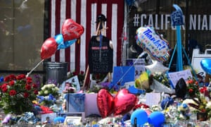 A makeshift memorial for Nipsey Hussle sits in the parking lot in front of his Marathon Store in Los Angeles.
