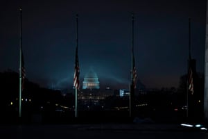 The US flag flies at half-mast in front of the Washington Monument and US Capitol in tribute to former president George H W Bush