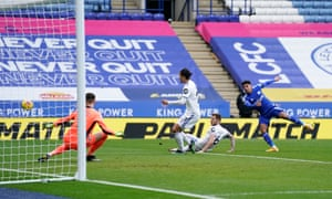 James Justin of Leicester City has a shot blocked by Liam Cooper.