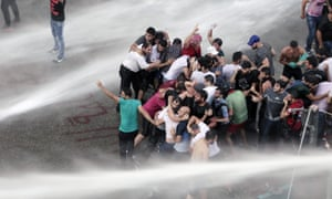 Lebanese activists are sprayed by riot police using water cannons during Sunday's protest.