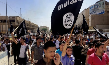 Isis supporters march in Mosul in 2014 as the city fell to the terror group.