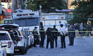 NYPD officer fatally shot in car by man later killed by