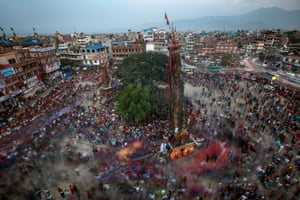 Lalitpur, Nepal Devotees pull a giant wooden chariot