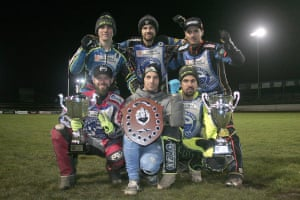 Workington Comets riders after their final meeting of the 2018 season with the League Championship, KO Cup and Championship Shield trophies.