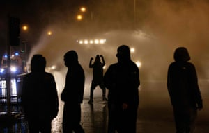 Officers use water cannon to deter nationalist youths