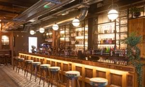 Stools at the bar, at Liverpool Gin Distillery, Liverpool, UK.