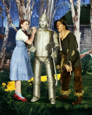 Judy Garland in her ruby slippers as Dorothy in the Wizard of Oz (1939) with Ray Bolger and Jack Haley (right).