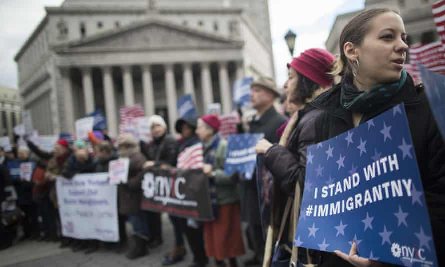 Demonstrators take part in a rally in support of Muslims and immigrants Friday in New York City.