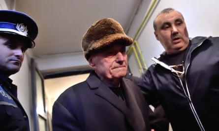 Police take former prison commander Alexandru Visinescu to jail in Romania.