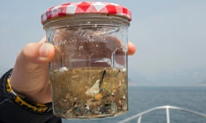 A glass jar containing a sample of microplastics collected in a fine mesh trawl of sea surface microplastics in Hong Kong.