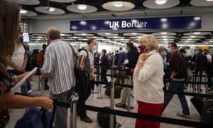 Passengers arrive at Terminal 5 at Heathrow airport.