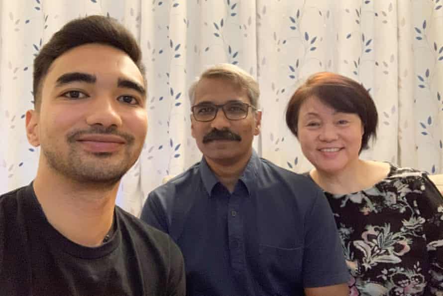 David with his parents.