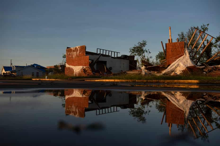 A destroyed building is reflected in standing water after Hurricane Delta landed in Lake Charles, Louisiana on 10 October.