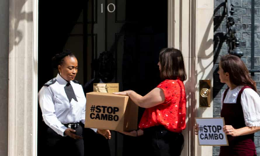 Friends of the Earth Scotland campaigners deliver a petition to Downing Street on 5 August, opposing the Cambo oil field.