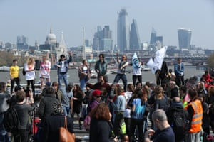 Environmental protesters from the Extinction Rebellion arrive to stage a demonstration, on Waterloo Bridge