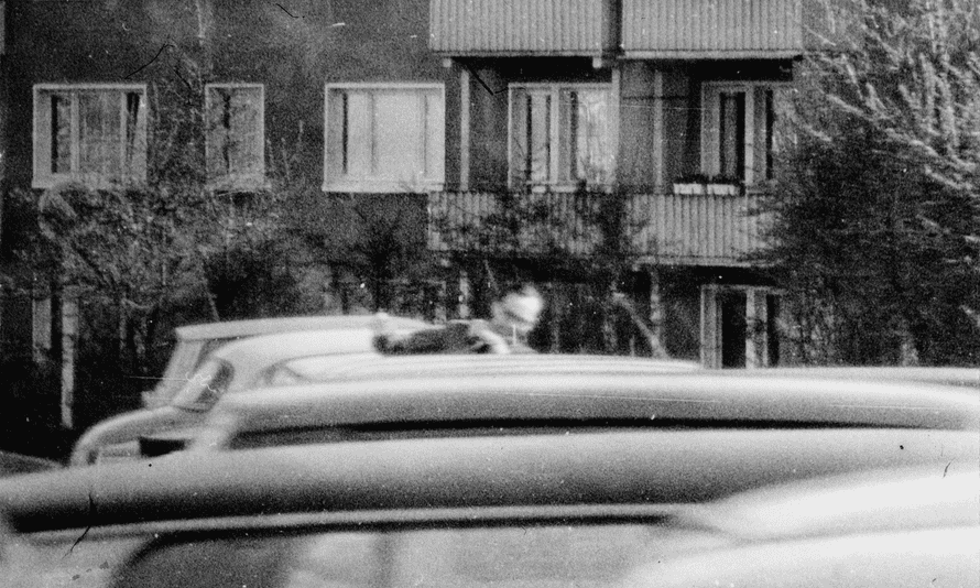 Leading Stasi official accidentally photographed as he leaves the flat where he was having an affair