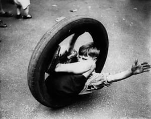 Child rolling in a motor tyre in 1933