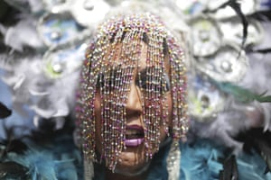A reveller participates in the gay pride parade held in support of peace and against sexual discrimination