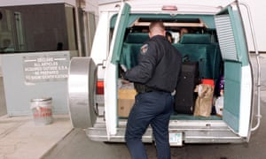 A US customs agent searches the back of a van in Detroit at the Canada border crossing. Sardar Ahmad was detained en route to Michigan.