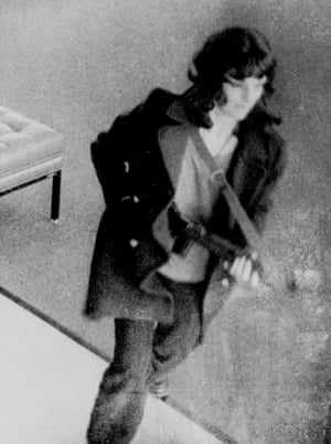 Patty Hearst caught on camera during a robbery in San Francisco.