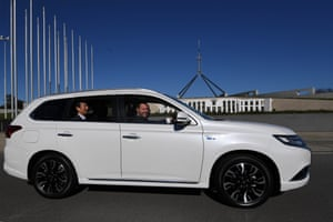 Energy minister Josh Frydenberg drives an electric car during an event outside Parliament House.
