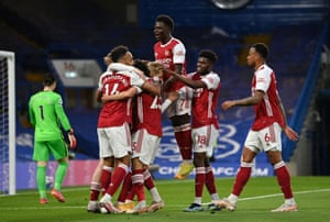 Arsenal's Emile Smith-Rowe is mobbed by his teammates after opening the scoring.