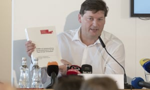 Ulrich Weber speaks at a press conference to announce the release of the final report