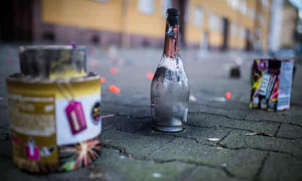 A bottle used to light rockets stands on a street next to other leftovers from new years celebrations in Berlin last year.