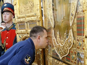 Rostov-on-Don, Russia: A serviceman kisses the newly crafted main icon at a church in Rostov-on-Don. The icon has been made for the armed forces cathedral, scheduled to be built in Kubinka outside Moscow by 2020, in time for the 75th anniversary of the end of the second world war