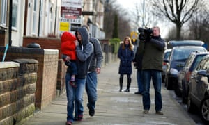 A video crew follows a resident of James Turner Street, Birmingham, for the Channel 4 documentary Benefits Street in 2014.