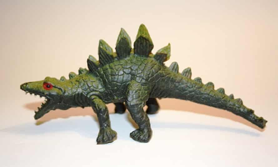 Rubber Stegosaurus complete with glowering red eyes, shark-like teeth and a lizard sprawl