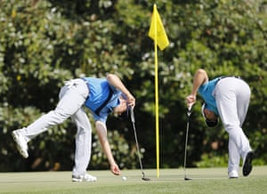 Spieth and Henrik Stenson of Sweden pick up their balls on the 11th