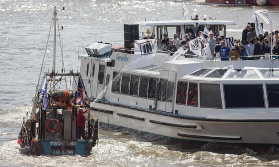 A boat in the leave flotilla sprays water at remain campaigners including Bob Geldof.