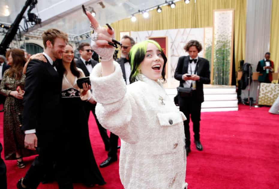 Billie Eilish arrives wearing an oversized Chanel trousersuit at the 92nd Academy Awards in Hollywood.