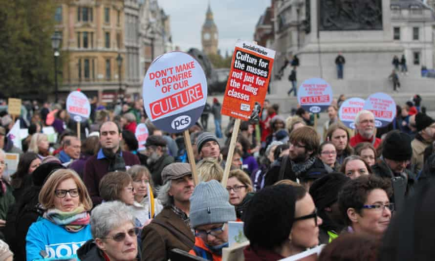 Hundreds of campaigners rally against funding cuts to libraries, museums and galleries outside The National Gallery in London