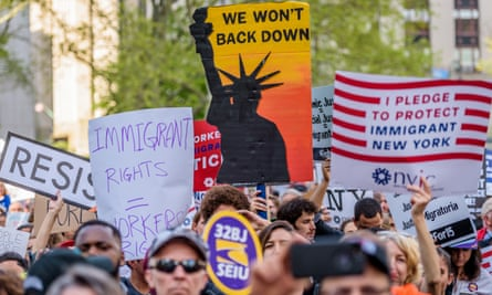 A placard reading 'Immigrant rights = workers' rights' is seen as immigrants, workers and activists march in New York City on 1 May 2017.