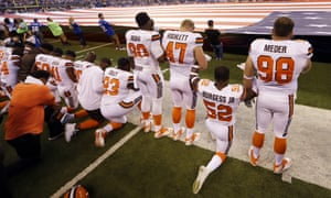 Members of the Cleveland Browns take a knee during the national anthem in Indianapolis, Sunday, Sept. 24, 2017. (AP Photo/Michael Conroy)
