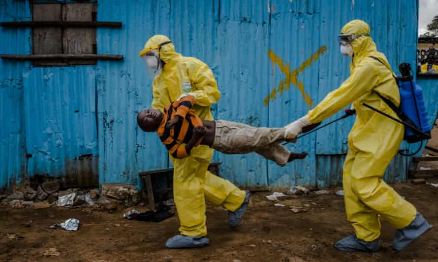 This 5 September 2014 photo by New York Times photographer Daniel Berehulak, part of a winning series, shows James Dorbor, 8, suspected of being infected with Ebola, being carried by medical staff to an Ebola treatment centre in Monrovia, Liberia.