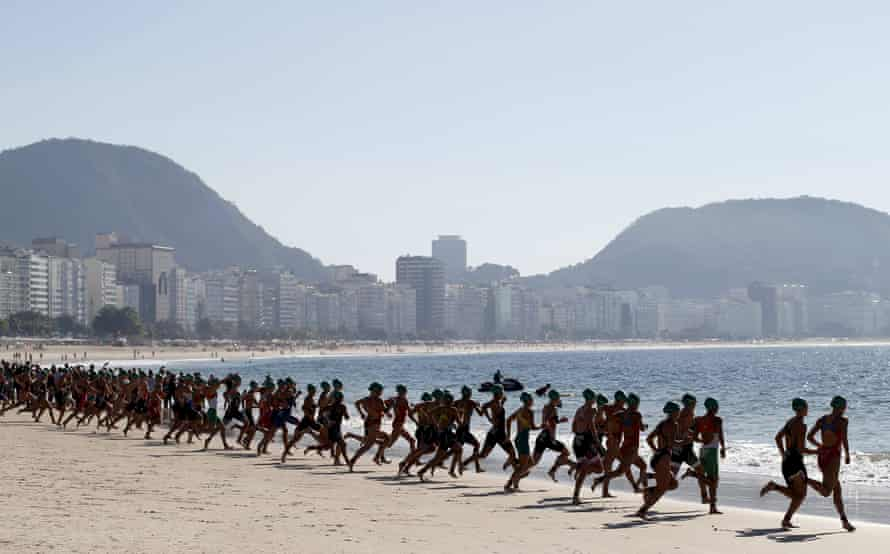 The swimming stage of the women's triathlon Olympic qualifier begins on Copacabana beach